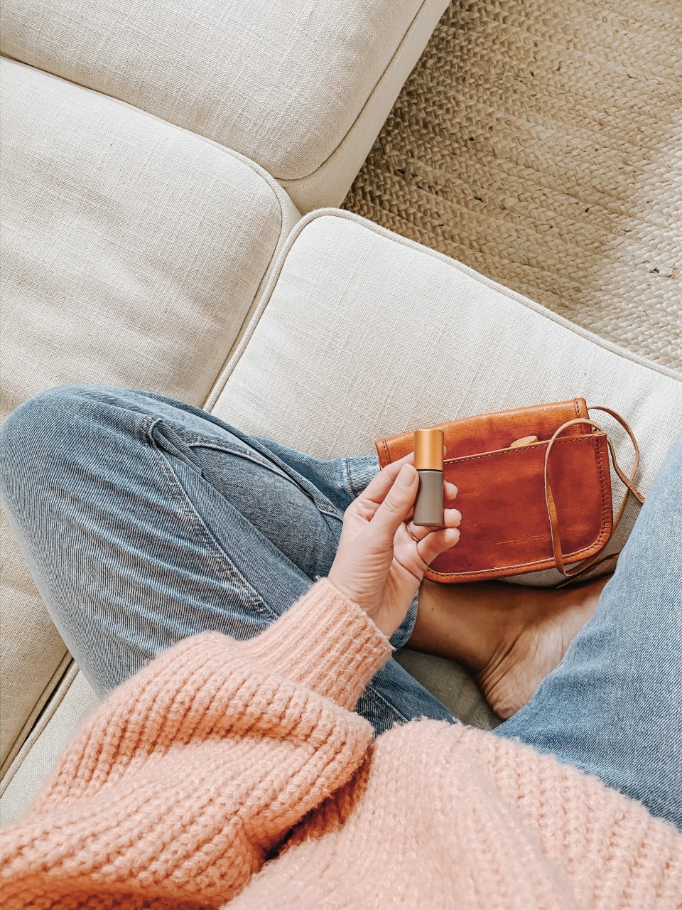 dunes collection roller bottle with young living essential oils and leather purse Emily Sue Netz for Whimsy and Wellness