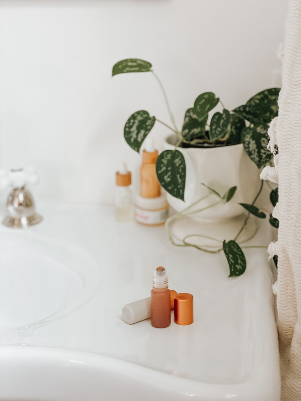 dunes collection roller bottle on white farmhouse sink Emily Sue Netz for Whimsy and Wellness