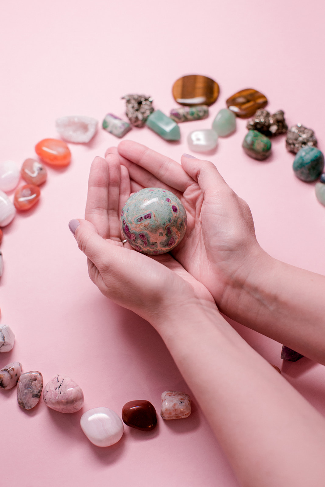 holding ruby fuchsite sphere crystal whimsy + wellness