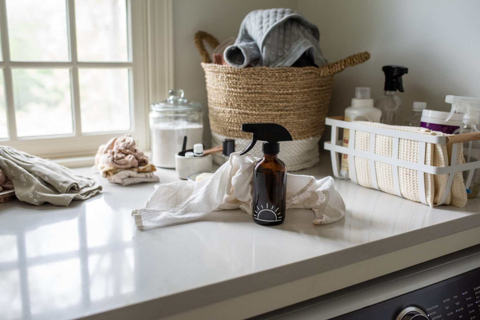 so fresh so clean whimsy + wellness spring cleaning amber glass bottle in laundry room