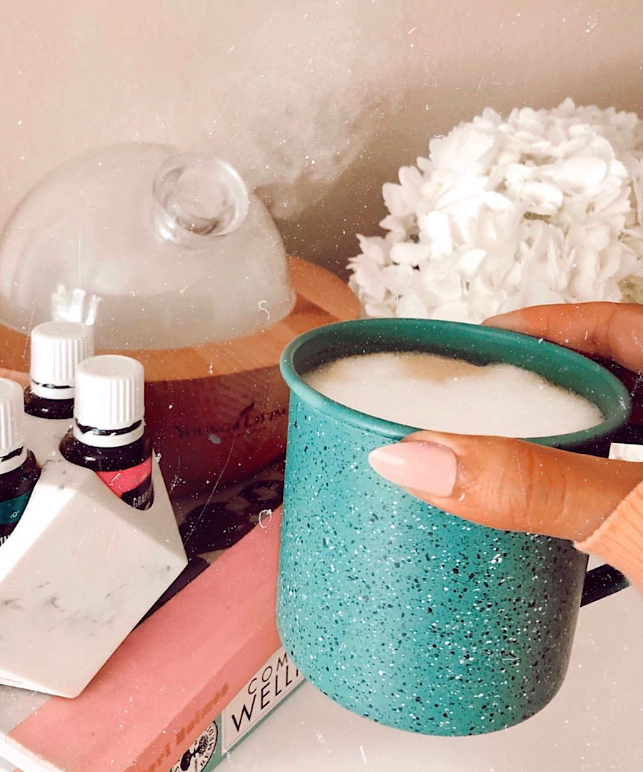 Brittney has her morning oat milk latte while diffusing energizing essential oils by Young Living