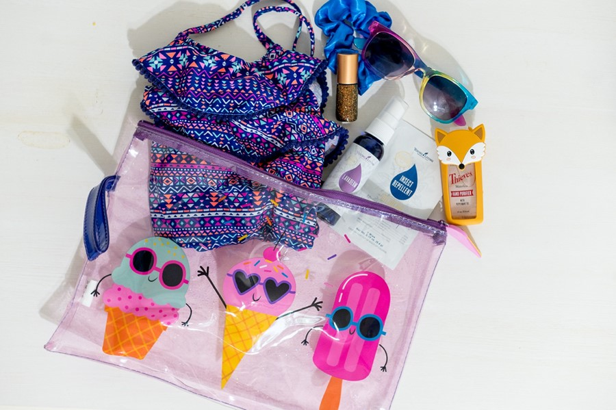 LaTisha shares summer essentials by Young Living, Lavaderm spray, insect repellent, thieves hand sanitizer, using a Whimsy + Wellness twinkle roller