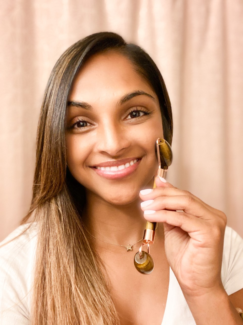 Anjali uses a Whimsy + Wellness gemstone facial roller as part of her skincare routine