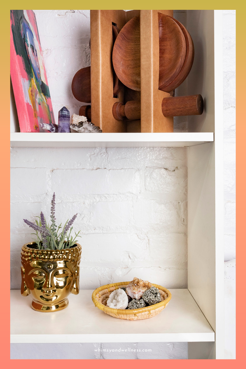 crystals displayed in home on bookshelf with whitewashed brick